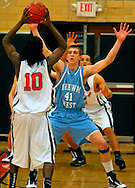 4 FEB. 2010 -- WEBSTER GROVES, Mo. --  Parkway West's Larry Toomey (41) guards Webster Groves' Derrick Dilworth (10) during the game Thursday, Feb. 4, 2010 between Webster Groves and Parkway West at Webster Groves High School. Photo (c) copyright by Sid Hastings.
