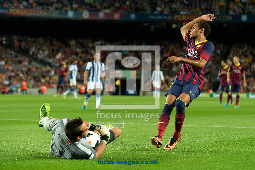 Picture by Cristian Trujillo/Focus Images Ltd +34 64958 5571<br /> 24/09/2013<br /> Neymar Jr of FC Barcelona and Claudio Bravo of Real Sociedad during the La Liga match at Camp Nou, Barcelona.
