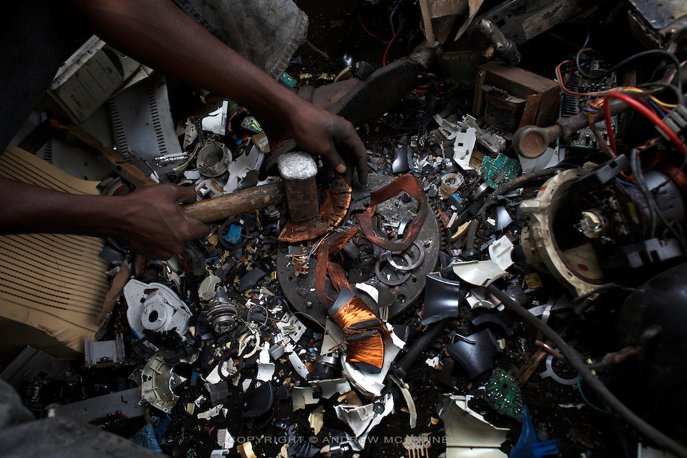 Copper is retrieved from a computer monitor at Agbogbloshie dump, in Accra, Ghana.
