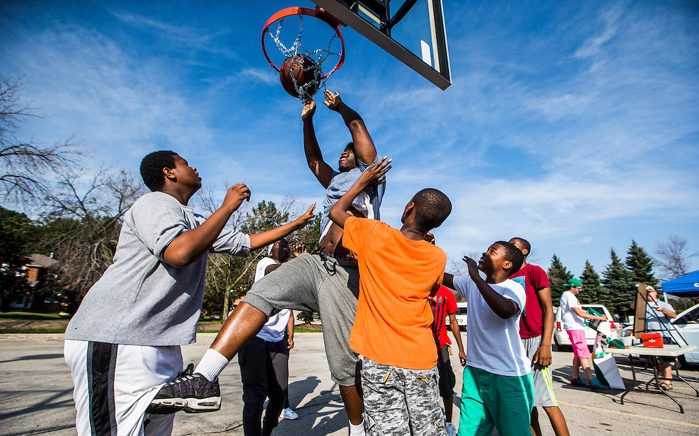 Mississauga , Ontario - August 19, 2015 -- Basketball -- Javon Morgan goes to the net on a temporary basketball court set up by the Erin Mills Youth Centre during a community event in a parking lot in Mississauga, Thursday August 19, 2015   (Mark Blinch for the Globe and Mail)