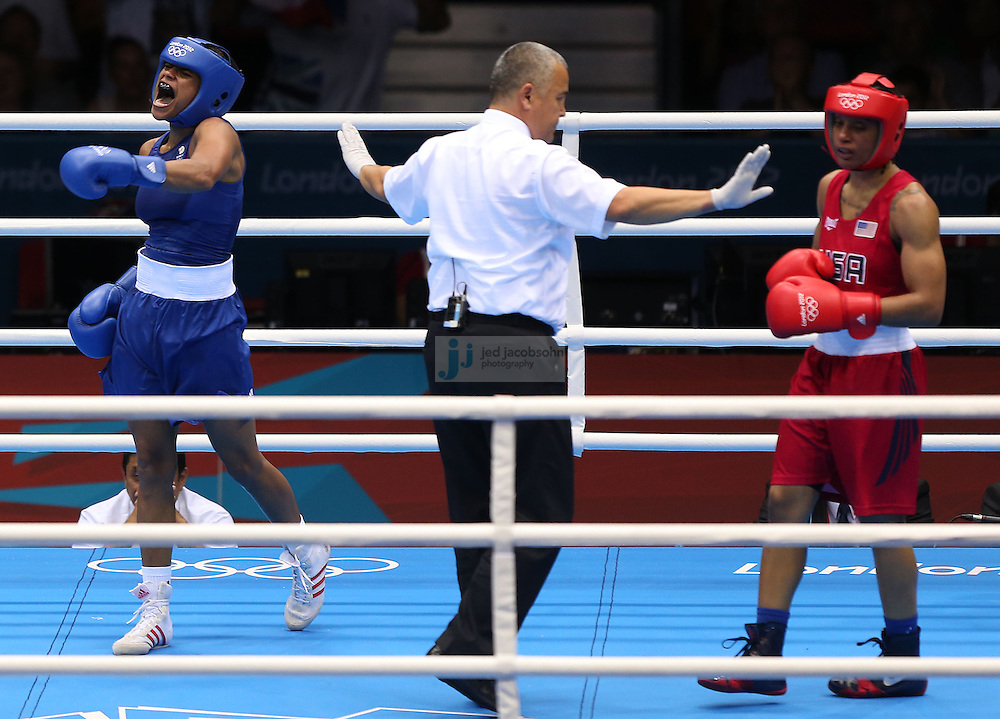 Natasha Jonas of Great Britain celebrates after defeating Quanitta Underwood of the USA during women's boxing at the Excel center during day 9 of the London Olympic Games in London, England, United Kingdom on August 3, 2012..(Jed Jacobsohn/for The New York Times)..