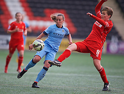 WIDNES, ENGLAND - Sunday, April 26, 2015: Manchester City's Natasha Harding and Liverpool's Katrin Omarsdottir during the FA Women's Super League match at the Halton Stadium. (Pic by David Rawcliffe/Propaganda)