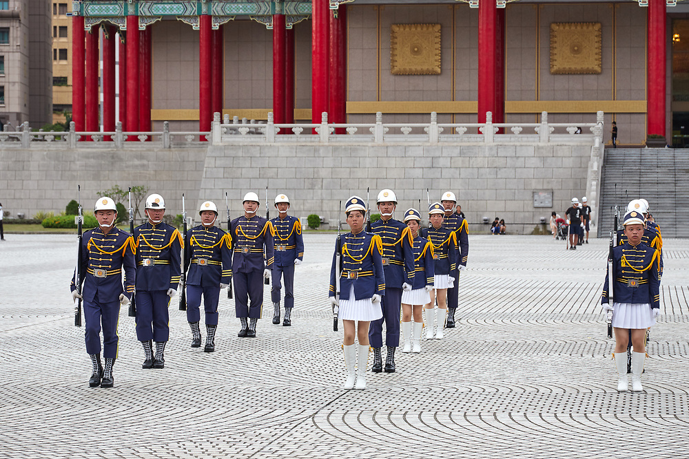 Honor guards rehearsing in public ahead of an official state event.