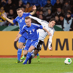 15.10.2013, Kassel, GER, UEFA U21 EM Qualifikation, Deutschland vs Faroer Inseln, Gruppe 6, 8. Runde, im Bild Kampf um den Ball zwischen Beinur Ellefsen (Faroer Isl, s U21) (hinten), Barour Hansen (Faroer Isl, s U21) (L), Nico Schulz (Deutschl, U21, Hertha BSC), Aktion, Action // during the UEFA U21 European Championship group six 8th round qualifier between Germany and Faroe Islands at the Kassel, Germany on 2013/10/15. EXPA Pictures © 2013, PhotoCredit: EXPA/ Eibner-Pressefoto/ Sippel<br /> <br /> *****ATTENTION - OUT of GER*****