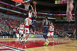 Louisville forward Montrezl Harrell, left, blocks a shot by Notre Dame forward Zach Auguste in the second half. <br /> <br /> The University of Louisville hosted the Notre Dame, Wednesday, March 04, 2015 at Yum Center in Louisville. <br /> <br /> Photo by Jonathan Palmer