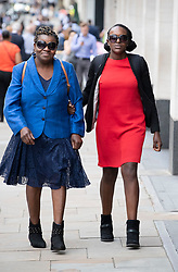 © Licensed to London News Pictures. 06/08/2019. London, UK. Former Labour Member of Parliament Fiona Onasanya (R) arrives with her mother Paulina at the Solicitors Disciplinary Tribunal in London. Ms Onasanya, a commercial property specialist lawyer, is charged with failing to uphold the proper administration of justice, failing to act with integrity and failing to behave in a way that maintains the trust the public places in her and the provision of legal services. Photo credit: Peter Macdiarmid/LNP