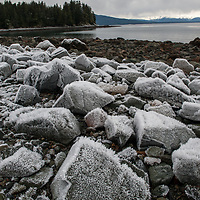 As I explored North Douglas in Juneau, Alaska, I came across some frost on the rocks by the water. With the large change in tides which takes place every six hours this is not too uncommon as the weather starts to get cooler as was the case when I took this in November one year. As I got closer to the rocks the detail which could be found on each one was quite interesting and also caught my attention to photograph for a little while.