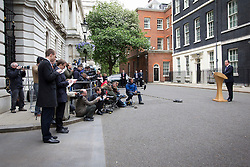 © Licensed to London News Pictures. 23/05/2013. London, UK. The British Prime Minister, David Cameron, makes a statement to the media outside Number 10 Downing Street in London today (23/05/2013) after an a emergency meeting of COBRA (Cabinet Office Briefing Room A) to discuss yesterday's alleged terrorist attack in Woolwich. Photo credit: Matt Cetti-Roberts/LNP