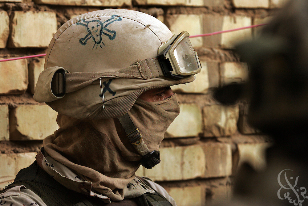 A skull and crossbones adorns the helmet of a 6th division, 2nd Batallion Iraqi Army soldier as he helps conduct house-to-house searches in the Amariyah district of Baghdad during an ongoing joint U.S.-Iraqi security operation in the Iraqi capital August 14, 2006.