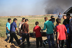June 6, 2017 - Jabalia, Jabalia, Gaza - Palestinian protesters during clashes following a demonstration against the blockade on the Gaza Strip Protest near the border fence east of Jabalia refugee camp, Gaza Strip, Palestinian territories. (Credit Image: © Nidal Alwaheidi/Pacific Press via ZUMA Wire)