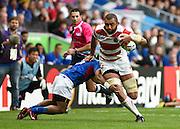 Japan back row Michael Leitch evades a tackle from Samoa scrum half Vavao Afemai during the Rugby World Cup Pool B match between Samoa and Japan at stadium:mk, Milton Keynes, England on 3 October 2015. Photo by David Charbit.