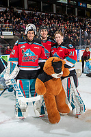 KELOWNA, BC - NOVEMBER 30: Roman Basran #30 Alex Swetlikoff #17 and Cole Schwebius #31 of the Kelowna Rockets pose on the ice with a bear during the annual teddy bear toss at Prospera Place on November 30, 2019 in Kelowna, Canada. (Photo by Marissa Baecker/Shoot the Breeze)
