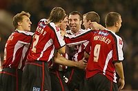Photo: Aidan Ellis.<br /> Sheffield Utd v Luton Town. Coca Cola Championship.<br /> 01/11/2005.<br /> Sheffield's Chris Morgan celebrates his goal with team mates David Unsworth and Alan Quinn