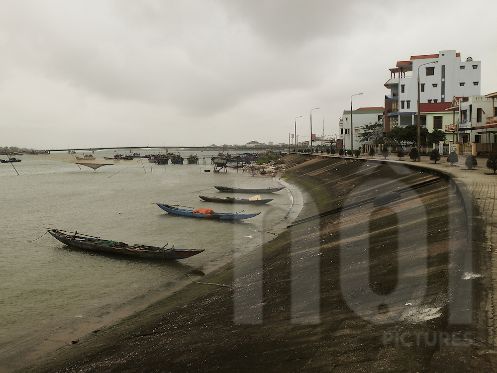 Harbour of Dong hoi, quang  binh, viet nam, Asia. Boats are lined up and anchored to seawall.