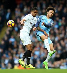 Leroy Sane of Manchester City collides with Kyle Naughton of Swansea City - Mandatory by-line: Matt McNulty/JMP - 05/02/2017 - FOOTBALL - Etihad Stadium - Manchester, England - Manchester City v Swansea City - Premier League