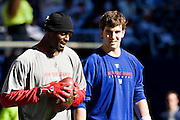 IRVING, TX - JANUARY 13:   Eli Manning #10 and Plaxico Burress #17 of the New York Giants warms up before a game against the Dallas Cowboys during the NFC Divisional playoff at Texas Stadium on January 13, 2008 in Dallas, Texas.  The Giants defeated the Cowboys 21-17.  (Photo by Wesley Hitt/Getty Images) *** Local Caption *** Eli Manning;Plaxico Burress