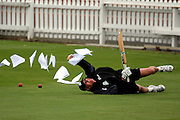 NZ coach John Bracewell desperately tries to stop paperwork from blowing away.<br /> National Bank Test Match Series, New Zealand v England, Black Caps Nets Practice. Allied Prime Basin Reserve, New Zealand. Tuesday, 11 March 2008. Photo: Dave Lintott/PHOTOSPORT