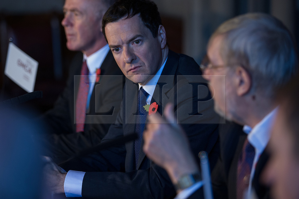 © Licensed to London News Pictures . 03/11/2014 . Manchester , UK . The Chancellor of the Exchequer , GEORGE OSBORNE MP , at Manchester Town Hall signing a deal to devolve power to Greater Manchester , including giving the city a Mayor and greater control over its finances . Photo credit : Joel Goodman/LNP