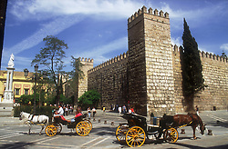 Exterior of the Alcazar; Seville; with tourist horse and buggy rides,