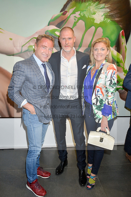Left to right, MICHAEL FLATLEY, JEAN DAVID MALAT and NIAMH FLATLEY at a private view of woks by German artist Mike Dargas held at the Opera Gallery, 134 New Bond Street, London on 5th July 2016.