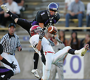 Box Elder cornerback Kade Anderson (top) goes up to knock the ball away from Weber receiver Spencer Storey for an incomplete pass in the third quarter of play, August 19, 2005. Box Elder defeated Weber 9-7 in their season opener. Photo by Colin Braley                               .                               .