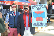Aaron Rutkowski carries a sign in the Grove in Oxford, Miss. on Saturday, October 4, 2014.