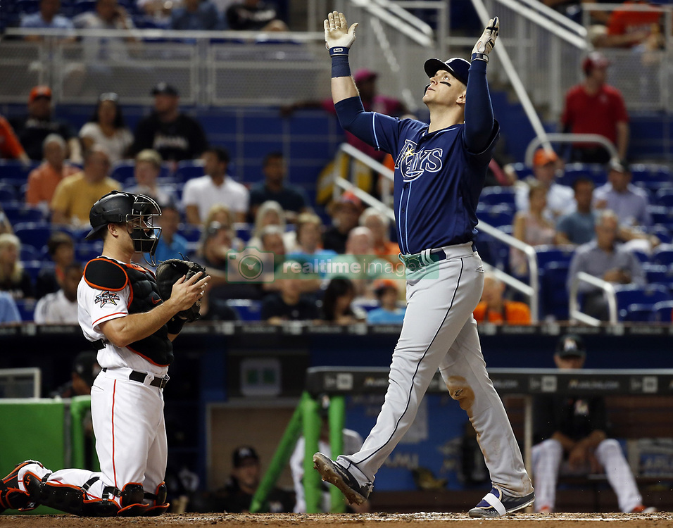 May 2, 2017 - Miami, FL, USA - The Tampa Bay Rays' Logan Morrison celebrates a home run when he crosses the plate as Miami Marlins catcher J.T. Realmuto looks on at Marlins Park in Miami on Tuesday, May 2, 2017. The Rays won, 3-1. (Credit Image: © Al Diaz/TNS via ZUMA Wire)
