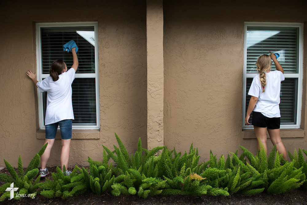 Krystal Hansen and Morgan Sims wash windows during a Y4Life servant event on Saturday, Sept. 12, 2015, at Redeeming Life Maternity Home in Sanford, Fla. LCMS Communications/Erik M. Lunsford