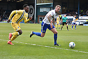 Bury Defender, Peter Clarke in action during the Sky Bet League 1 match between Bury and Millwall at the JD Stadium, Bury, England on 23 April 2016. Photo by Mark Pollitt.