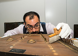 Conservator Jonathan Santa Maria Bouquet works on an 18th century dulcimer as part of the newly-refurbished St Cecilia's Hall, which has just undergone a 2 year, £6.5 million refurbishment which will see more of the University of Edinburgh's musical instrument collection on display to the public.<br /> <br /> © Dave Johnston/ EEm