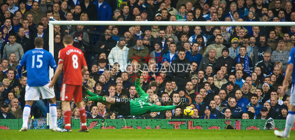 LIVERPOOL, ENGLAND - Sunday, November 29, 2009: Everton's goalkeeper Tim Howard watches helplessly as Javier Mascherano scores the opening goal during the Premiership match at Goodison Park. The 212th Merseyside Derby. (Photo by David Rawcliffe/Propaganda)