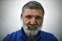 "Moshe Baranes, 40, a city hall worker and student, and a resident of the Gush Katif settlements, is seen in Gaza, Palestinian Territories, Nov. 4, 2004. When asked his thoughts about being forced to leave the settlements, he responded, ""God willing, we will do everything in our power not to be separated. I pray this is not going to happen."" Israel's parliament recently supported compensation payments for Jewish settlers leaving the Gaza Strip, in a vital vote for Prime Minister Ariel Sharon's plan to evacuate the occupied territory."