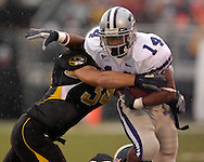 Kansas State running back Leon Patton (14) tries to brake away from Missouri linebacker Brock Christopher (34) in the first half at Faurot Field in Columbia, Missouri, October 21, 2006.  The Tigers beat the Wildcats 41-21.<br />