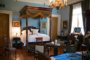 Oak Alley plantation antebellum mansion house interior of master bedroom with four poster bed in Vacherie, Louisiana, USA