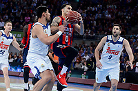 Baskonia's Shane Larkin and Real Madrid's Gustavo Ayon during Semi Finals match of 2017 King's Cup at Fernando Buesa Arena in Vitoria, Spain. February 18, 2017. (ALTERPHOTOS/BorjaB.Hojas)