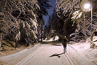 Christine Harrison cross country skiing (classic), on a snowy evening at the Lost Lake trails, Whistler, BC