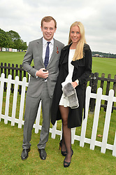 The EARL OF MEDINA and INGA IBERG HANSTVEIT at the Cartier Queen's Cup Polo final at Guard's Polo Club, Smiths Lawn, Windsor Great Park, Egham, Surrey on 14th June 2015