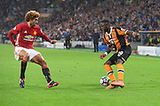 Hull City Striker Adama Diomande (20) and Manchester United player Marouane Fellaini (27)  during the Premier League match between Hull City and Manchester United at the KCOM Stadium, Kingston upon Hull, England on 27 August 2016. Photo by Ian Lyall.