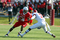 15 October 2011: Matt Younger makes a cut to get past Chris Frierson during an NCAA football game between the University of South Dakota Coyotes and the Illinois State Redbirds (ISU) at Hancock Stadium in Normal Illinois.
