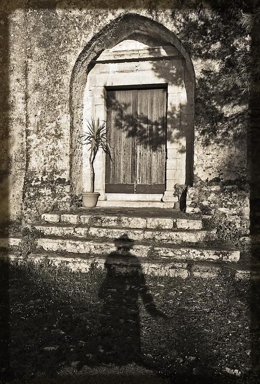 A man casts his shadow on a church entrance