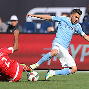 David Villa, NYCFC, is tackled by Andrew Farrell, New England Revolution, during the New York City FC Vs New England Revolution, MSL regular season football match at Yankee Stadium, The Bronx, New York,  USA. 26th March 2016. Photo Tim Clayton