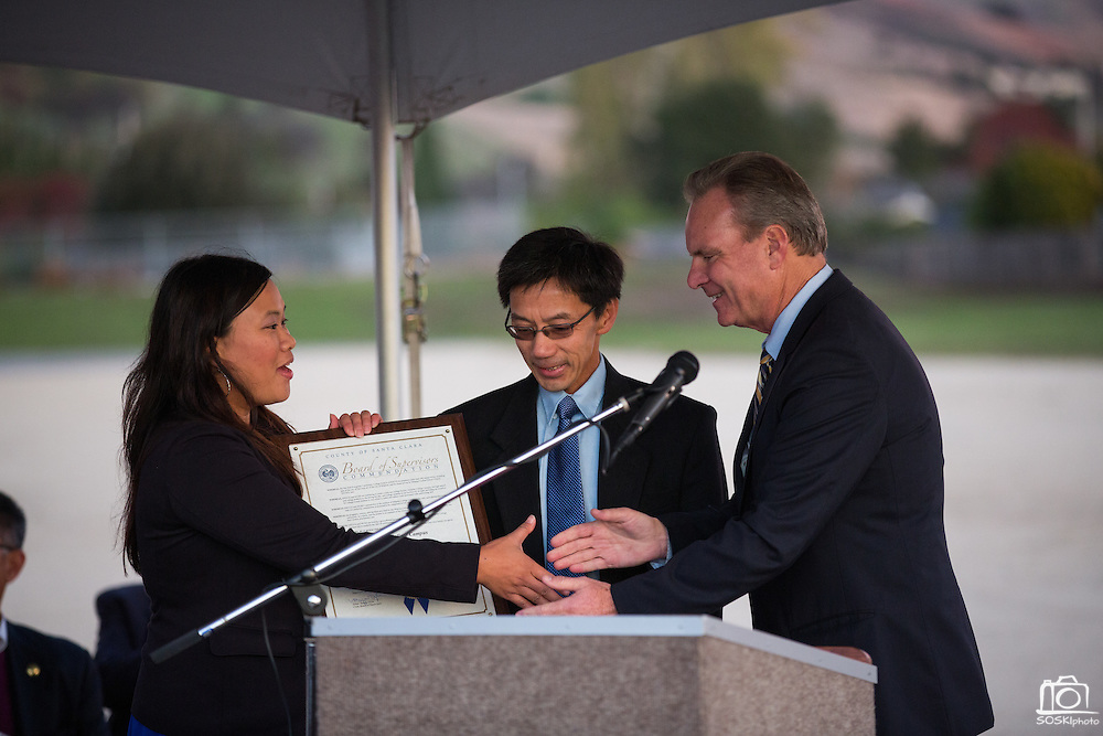 Santa Clara County Board of Supervisors President Dave Cortese presents MUSD Board of Trustees President Danny Lau, and SJECCD Board of Trustees President Wendy Ho with a Board of Supervisors Commendation during the Milpitas Unified School District and San Jose Evergreen Community College District Community College Extension Ground Breaking Ceremony near Russell Middle School in Milpitas, California, on November 17, 2015. (Stan Olszewski/SOSKIphoto)