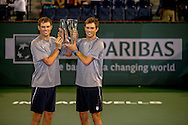 Indian Wells, CA - Bob and Mike Bryan hold the championship trophy at the BNP Paribas Open.