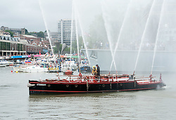 © Licensed to London News Pictures.16/07/2016. Bristol, UK. The Pyronaut fire boat at the Bristol Harbour Festival. The festival started in 1971when a bunch of boat owners headed to the harbour to save the docks from being filled in. They succeeded, and the Bristol Harbour Festival has been going ever since. This year's maritime programme features sea rescue dogs, historic ships, boat racing, flyboarding, steamboats and more. Photo credit : Simon Chapman/LNP