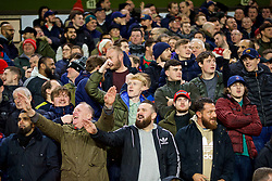 WOLVERHAMPTON, ENGLAND - Friday, December 21, 2018: Liverpool supporters celebrate as their side win 2-0 to remain top of the league at Christmas during the FA Premier League match between Wolverhampton Wanderers FC and Liverpool FC at Molineux Stadium. (Pic by David Rawcliffe/Propaganda)