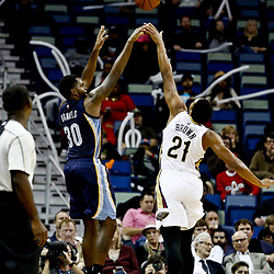 Dec 5, 2016; New Orleans, LA, USA; Memphis Grizzlies guard Troy Daniels (30) shoots over New Orleans Pelicans forward Anthony Brown (21) during the second half of a game at the Smoothie King Center. The Grizzlies defeated the Pelicans 110-108 in double overtime.  Mandatory Credit: Derick E. Hingle-USA TODAY Sports