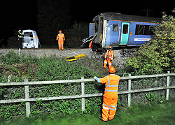 LITTLE CORNARD. SUDBURY. SUFFOLK.  Safety inspectors and Maintenance workers recover the train carriages and truck involved in yesterday's level crossing train crash. Twenty one people were hurt, two seriously, when a train derailed in a crash with a lorry on a level crossing. in Little Cornard in Suffolk on 17th August. 18 August 2010. STEPHEN SIMPSON..