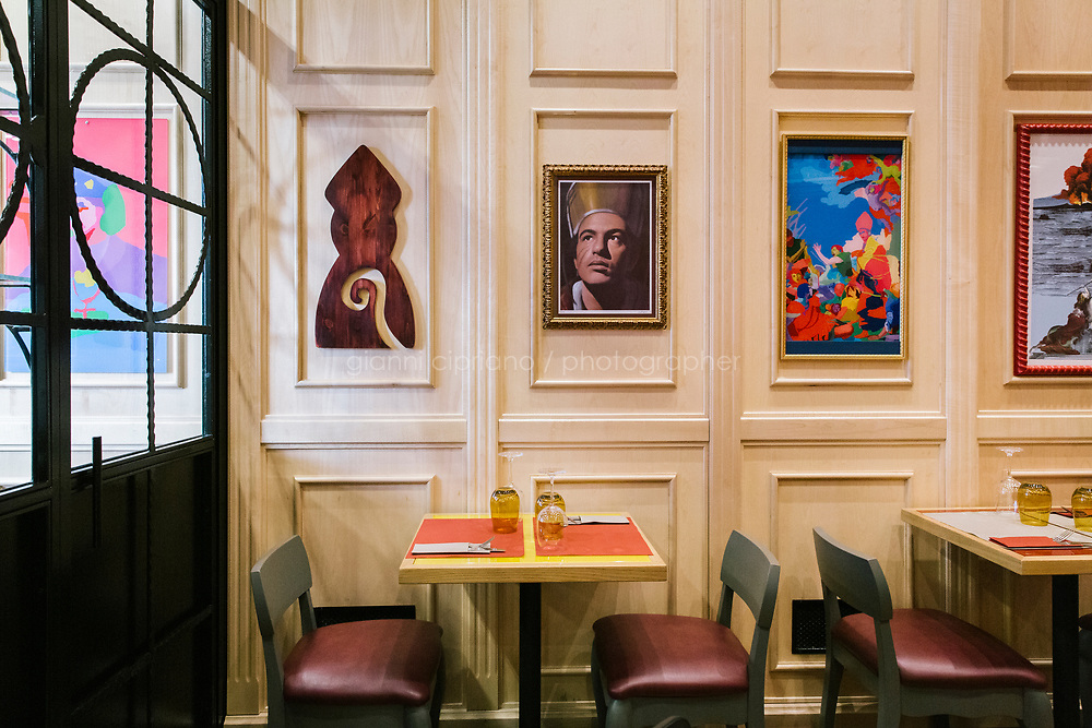 NAPLES, ITALY - 4 JANUARY 2019: Artwork inspired to Saint Janarius, the patron saint of Naples, is seen here at Janarius, a restaurant in Naples, Italy, on January 4th 2019.<br /> <br /> Janarius is a typical Neapolitan gourmet restaurant and shop founded by Francesco Andoli in September 2018 in via Duomo, in front of the Naples's Duomo and treasure of Saint Janarius. Saint Janarius is the patron saint of Naples. Saint Janarius is the patron saint of Naples.