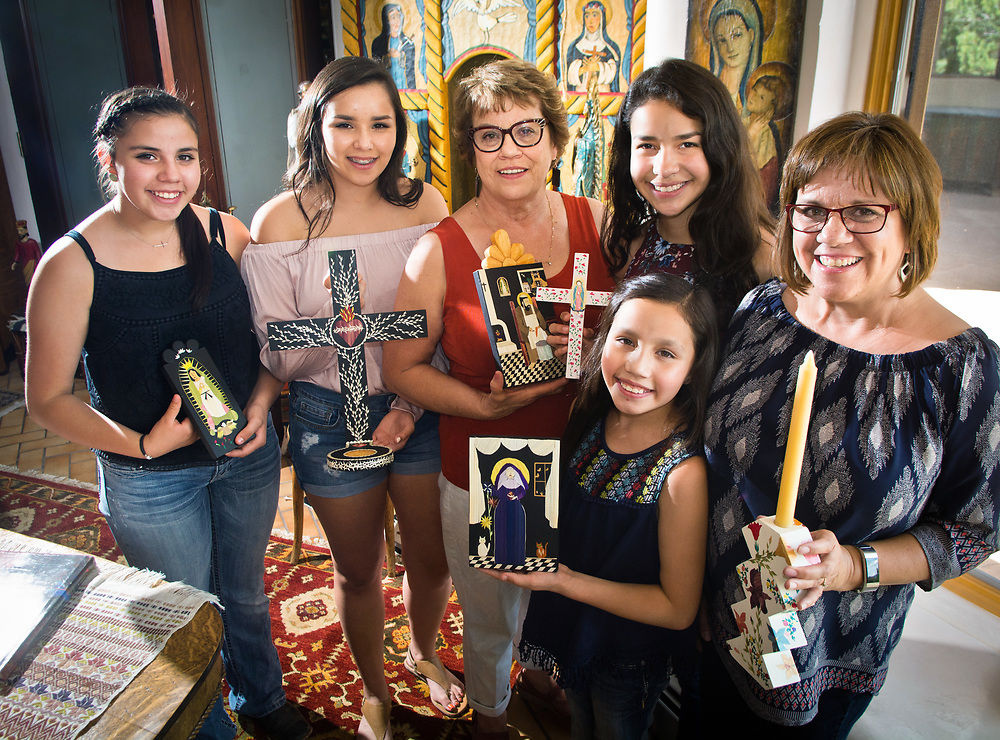mkb072517d/North/Marla Brose --  Diana Moya-Lujan, a straw applique artist, living in Santa Fe, will be showing work at Spanish Market along with her daughter and four granddaughters. From left, is Emma Lujan-Davis, Madison Lujan-Davis, 16, Diana Moya-Lujan, Hannah Lujan-Davis, 11, bottom, Andrea Torres, 15, and Lenise Lujan-Martinez.(Marla Brose/Albuquerque Journal)