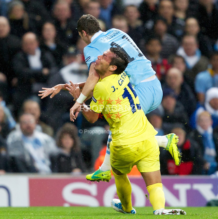 MANCHESTER, ENGLAND - Tuesday, Octover 18, 2011: Manchester City's Edin Dzeko in action against Villarreal CF's Jose Catala during the UEFA Champions League Group A match at the City of Manchester Stadium. (Pic by Vegard Grott/Propaganda)